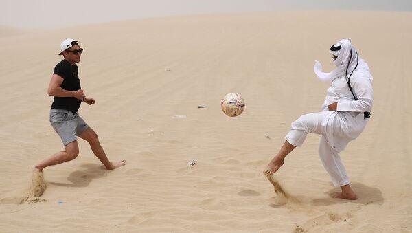 Playing football in the desert of Khor Al Adaid, Doha, State of Qatar. - Sputnik International