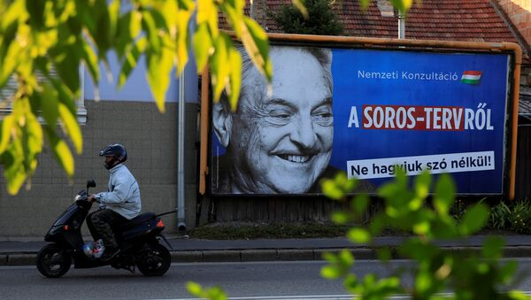 A man rides his moped past a government billboard displaying George Soros in monochrome next to a message urging Hungarians to take part in a national consultation about what it calls a plan by the Hungarian-born financier to settle a million migrants in Europe per year, in Szolnok, Hungary, October 2, 2017 - Sputnik International
