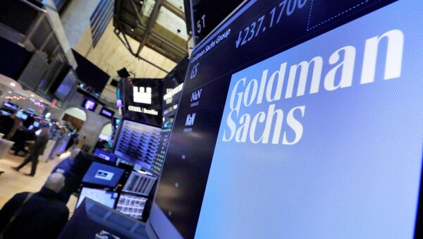 The logo for Goldman Sachs appears above a trading post on the floor of the New York Stock Exchange (File) - Sputnik International