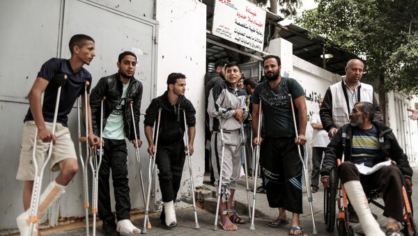 Palestinians, wounded in previous weeks during mass protests against Israeli forces along the border of the Palestinian enclave, dubbed The Great March of Return, await medical check-up at the Doctors Without Borders (MSF) clinic in Gaza City (File) - Sputnik International