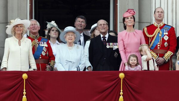 Members of Britain's Royal family from left, Camilla, the Duchess of Cornwall, Prince Charles, Princess Eugenie, Queen Elizabeth II, background Timothy Laurence, Princess Beatrice, Prince Philip, Kate, the Duchess of Cambridge, Princess Charlotte, Prince George and Prince William watch a fly past as they appear on the balcony of Buckingham Palace, after attending the annual Trooping the Colour Ceremony in London, Saturday, June 17, 2017 - Sputnik International