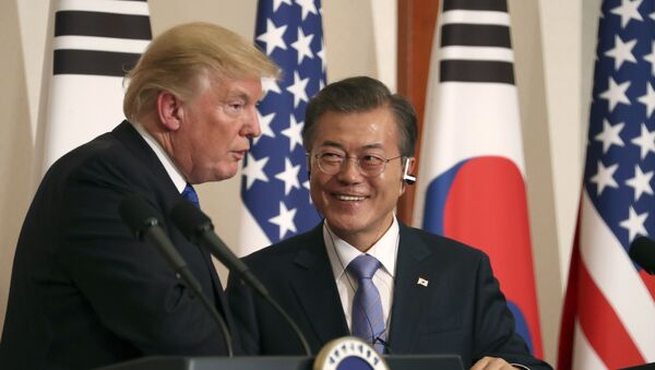 President Donald Trump, left, speaks as South Korean President Moon Jae-in looks on during a joint news conference at the Blue House in Seoul, South Korea, Tuesday, Nov. 7, 2017 - Sputnik International