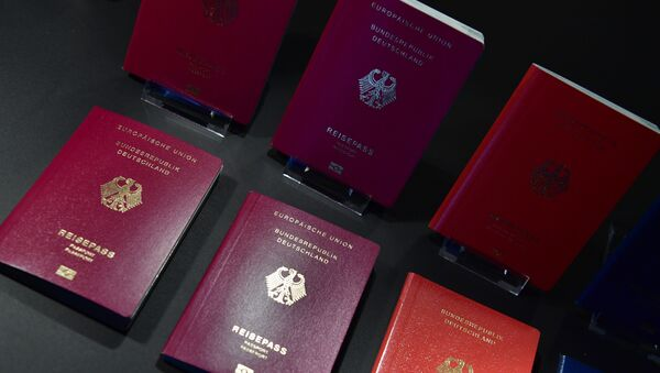 The new German electronic passport is presented during an official press conference on February 23, 2017 in Berlin - Sputnik International
