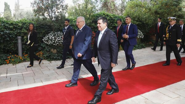 Paraguayan President Horacio Cartes walks next to Israeli President Reuven Rivlin upon his arrival for a meeting at the Israeli president's residence in Jerusalem, ahead of the dedication ceremony of the embassy of Paraguay in Jerusalem, May 21, 2018 - Sputnik International