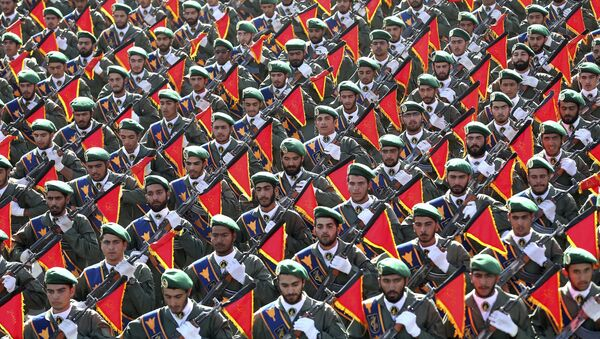 In this Sept. 21, 2016 file photo, Iran's Revolutionary Guard troops march in a military parade marking the 36th anniversary of Iraq's 1980 invasion of Iran, in front of the shrine of late revolutionary founder Ayatollah Khomeini, just outside Tehran, Iran - Sputnik International
