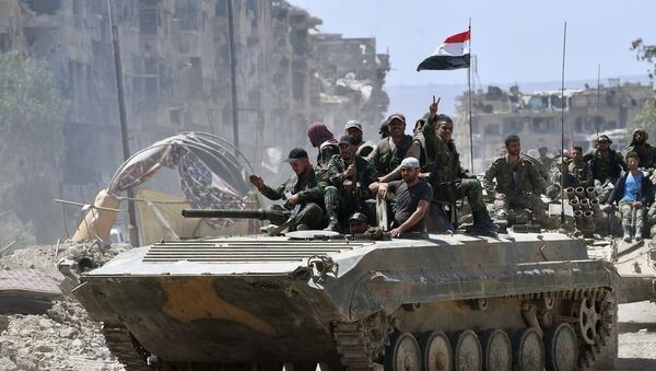 Service personnel of the Syrian Army on a BMD-1 in the liberated Palestinian refugee camp of Yarmouk south of Damascus - Sputnik International