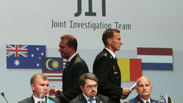 Members of a joint investigation team present the preliminary results of the criminal investigation into the downing of Malaysia Airlines flight MH17 , in Nieuwegein, on September 28, 2016 - Sputnik International