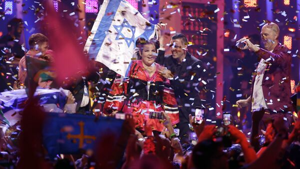 Netta from Israel celebrates after winning the Eurovision Song Contest grand final in Lisbon, Portugal, Saturday, May 12, 2018 - Sputnik International