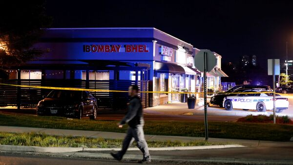 A police officer walks in front of Bombay Bhel restaurant, where two unidentified men set off a bomb late Thursday night, wounding more than a dozen people, in Mississauga, Ontario, Canada May 25, 2018 - Sputnik International
