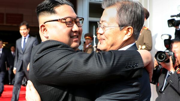 South Korean President Moon Jae-in bids fairwell to North Korean leader Kim Jong Un as he leaves after their summit at the truce village of Panmunjom, North Korea, in this handout picture provided by the Presidential Blue House on May 26, 2018 - Sputnik International