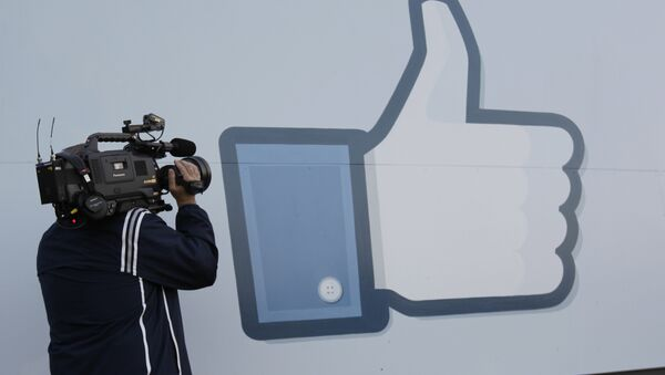 A television photographer shoots the Like sign outside of Facebook headquarters in Menlo Park, Calif - Sputnik International