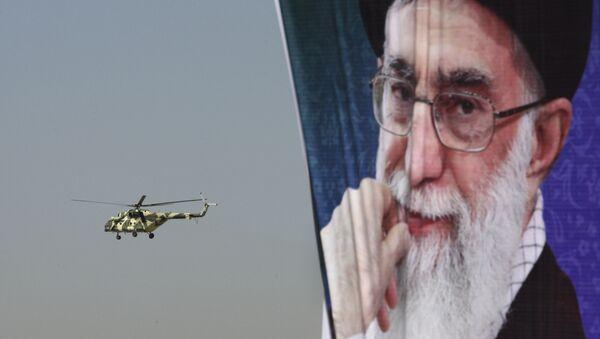 A police helicopter flies behind a poster of Iranian supreme leader Ayatollah Ali Khamenei - Sputnik International