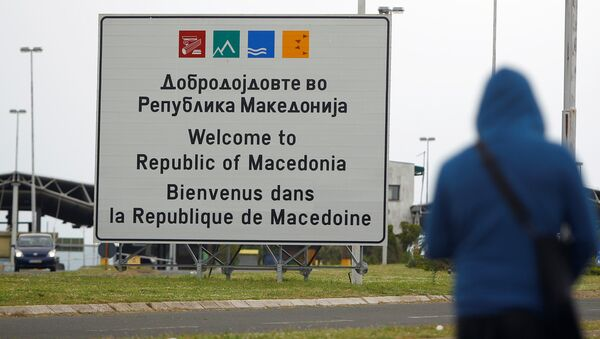 A person walks near a sign that reads welcome to Macedonia at the Macedonia-Greece border April 16, 2018 - Sputnik International