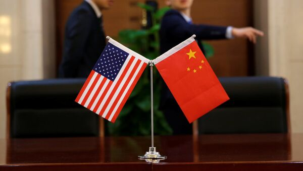 Chinese and U.S. flags are set up for a signing ceremony during a visit by U.S. Secretary of Transportation Elaine Chao at China's Ministry of Transport in Beijing, China April 27, 2018 - Sputnik International