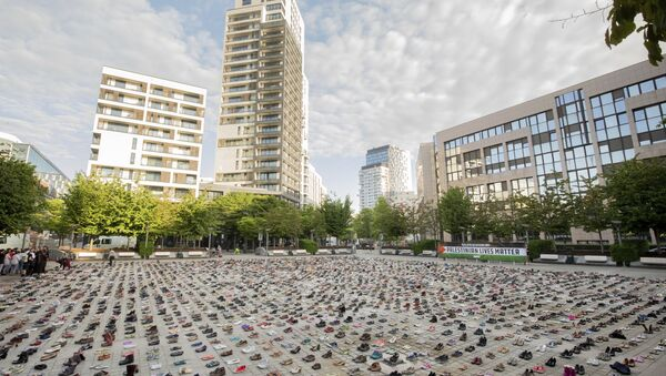 4,500 pairs of shoes are laid out in front of the European Parliament in Brussels ahead of the EU Foreign Affairs Council meeting by AVAAZ members on Monday, May 28, 2018. The AVAAZ campaign, Palestinian Lives Matter, are highlighting the Gaza tragedy with 4,500 pairs of shoes representing one pair for every life lost in this conflict in the last decade, in front of where ministers enter the Parliament building - Sputnik International