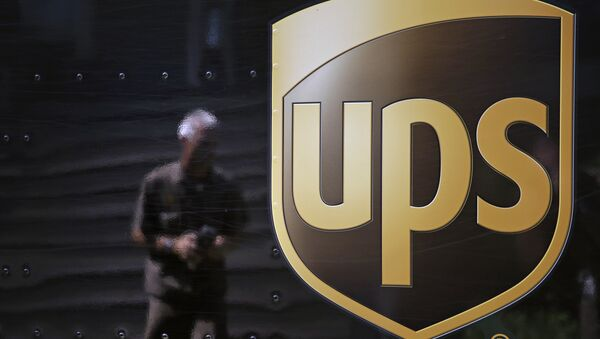 In this June 20, 2014, file photo, the United Parcel Service logo is seen on the side of a truck as driver Marty Thompson is reflected returning from a delivery in Cumming, Ga. - Sputnik International