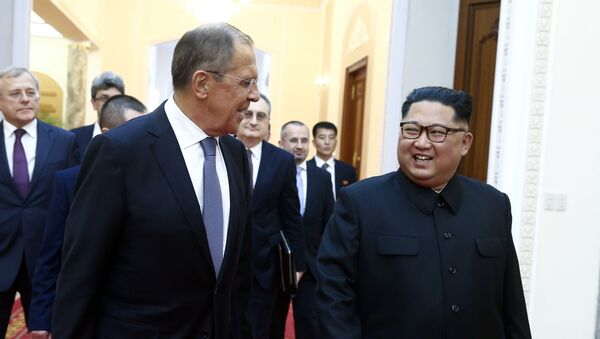 Russian Foreign Minister Sergei Lavrov, left, and North Korean leader Kim Jong Un meet in Pyongyang - Sputnik International