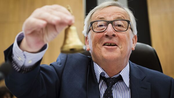 EU Commission President Jean-Claude Juncker rings the bell as he opens the college of commissioners at EU headquarters in Brussels, Wednesday, May 23, 2018 - Sputnik International