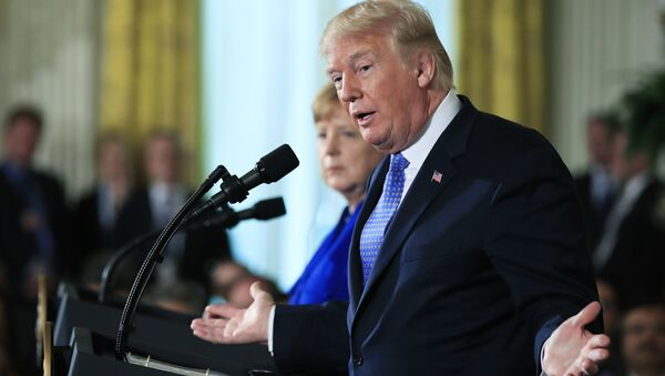 President Donald Trump with German Chancellor Angela Merkel speaks during a news conference in the East Room of the White House in Washington, Friday, April 27, 2018 - Sputnik International