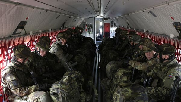 Czech Republic's soldiers from the 43rd airborne battalion sit inside an aircraft during the NATO drill The Noble Jump at the airport in Pardubice, Czech Republic (File) - Sputnik International