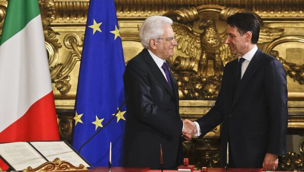 Italian President Sergio Mattarella, left, shakes hands with Premier Giuseppe Conte during the swearing-in ceremony for Italy's new government at Rome's Quirinale Presidential Palace, Friday, June 1, 2018 - Sputnik International
