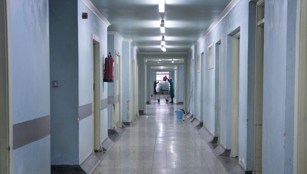 This photo taken Wednesday, Aug. 20, 2014 shows the rundown corridors of the general operating wing at the Mulago National Referral Hospital in Kampala, Uganda. - Sputnik International