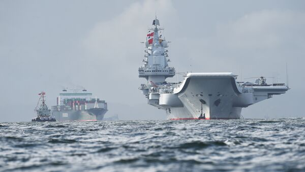 China's sole aircraft carrier, the Liaoning (R), arrives in Hong Kong waters on July 7, 2017, less than a week after a high-profile visit by president Xi Jinping - Sputnik International