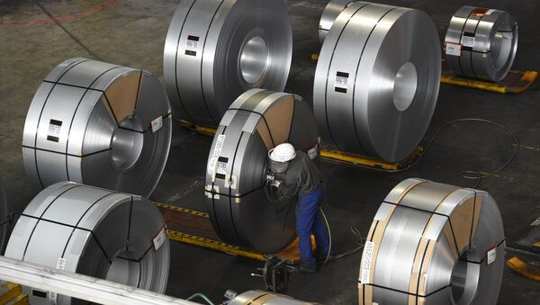 FILES) In this file photo taken on March 17, 2015 a worker packs coils for delivery at the production site of a German steel company in Salzgitter. Imposed stiff tariffs by the United States on European, Mexican and Canadian steel and aluminium, that have come into effect on June 1, 2018 - Sputnik International