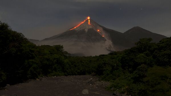 In this image taken with a long exposure, the Volcan de Fuego, or Volcano of Fire, spews hot molten lava from its crater in San Juan Alotenango, Guatemala, Wednesday, July 1, 2015 - Sputnik International