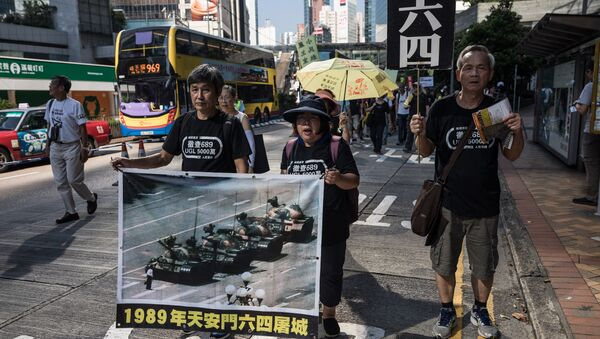 Protesters display a poster of the famous Tank Man standing in front of Chinese military tanks at Tiananmen Square in Beijing, during a rally in Hong Kong on May 28, 2017, ahead of the 28th anniversary of the June 4, 1989 Tiananmen Square crackdown - Sputnik International