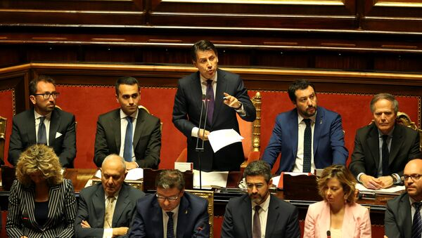 Newly appointed Italian Prime Minister Giuseppe Conte speaks next to Interior Minister Matteo Salvini, Minister of Labor and Industry Luigi Di Maio, Minister of Justice Alfonso Bonafede and Foreign Minister Enzo Moavero Milanesi during his first session at the Senate in Rome, Italy, June 5, 2018 - Sputnik International