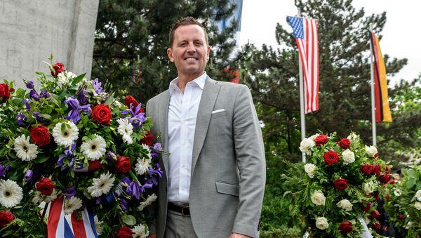 U.S. ambassador to Germany Richard Allen Grenell stands beside a wreath in Berlin, Germany, May 12, 2018 - Sputnik International