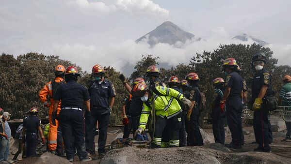 Firefighters carry the skeleton remains found buried at a house during a search at an area affected by the eruption of the Fuego volcano at El Rodeo in Escuintla - Sputnik International