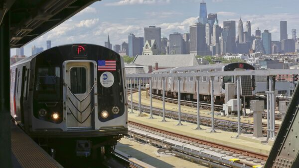 In this June 21, 2017 file photo, a subway train approaches the platform at Brooklyn's Smith Street above-ground subway station, in New York. - Sputnik International
