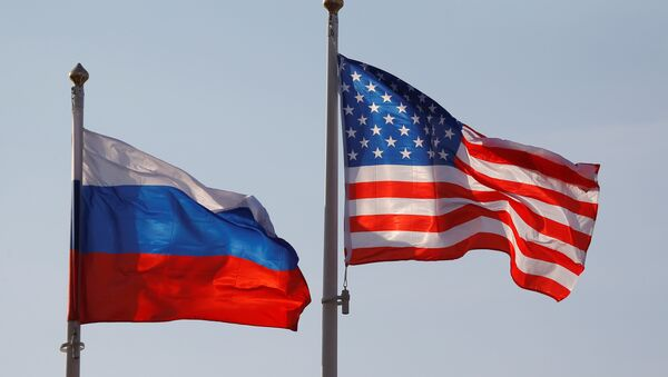 National flags of Russia and the US fly at Vnukovo International Airport in Moscow, Russia April 11, 2017 - Sputnik International