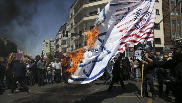 Iranian protesters burn a representation of the U.S. and Israeli flags in their annual anti-Israeli Al-Quds, Jerusalem, Day rally in Tehran, Iran, Friday, June 8, 2018 - Sputnik International