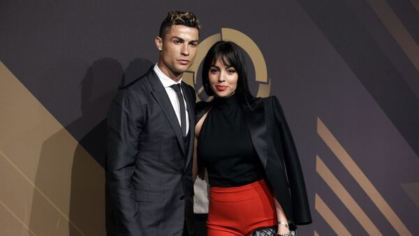 In this March 19, 2018 file photo, Real Madrid player Cristiano Ronaldo and his girlfriend Georgina Rodriguez pose for photos as they arrive for the Portuguese soccer federation awards ceremony in Lisbon - Sputnik International