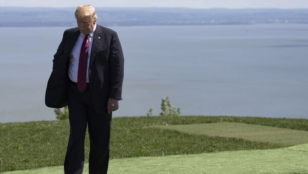 US President Donald Trump steps away after the family photo at the G7 Summit in La Malbaie, Canada, June 8, 2018. - Sputnik International