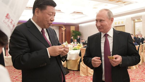 President Vladimir Putin and Chinese President Xi Jinping at a reception in Tianjin. - Sputnik International