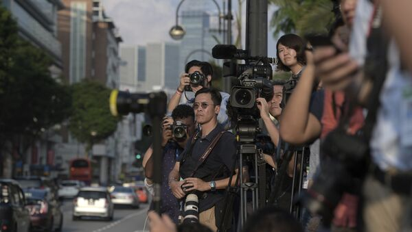Journalists wait for North Korean leader Kim Jong Un outside the Istana, or Presidential Palace, in Singapore, Sunday, June 10, 2018, Kim met with Singapore Prime Minister Lee Hsien Loong ahead of the summit with U.S. leader Donald Trump - Sputnik International