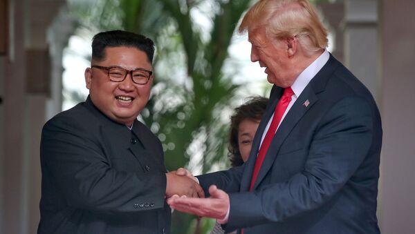 U.S. President Donald Trump meets North Korean leader Kim Jong Un at the Capella Hotel on Sentosa island in Singapore June 12, 2018. - Sputnik International