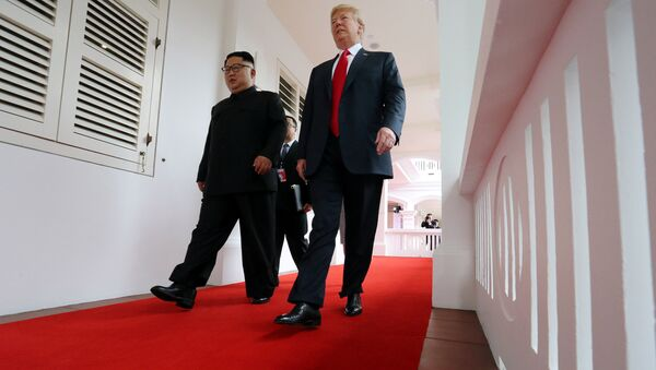 U.S. President Donald Trump walks with North Korean leader Kim Jong Un at the Capella Hotel on Sentosa island in Singapore June 12, 2018. - Sputnik International