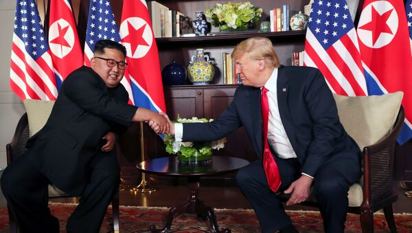 U.S. President Donald Trump shakes hands with North Korea's leader Kim Jong Un before their bilateral meeting at the Capella Hotel on Sentosa island in Singapore June 12, 2018. - Sputnik International