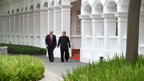 U.S. President Donald Trump and North Korean leader Kim Jong Un walk in the Capella Hotel after their working lunch, on Sentosa island in Singapore June 12, 2018 - Sputnik International