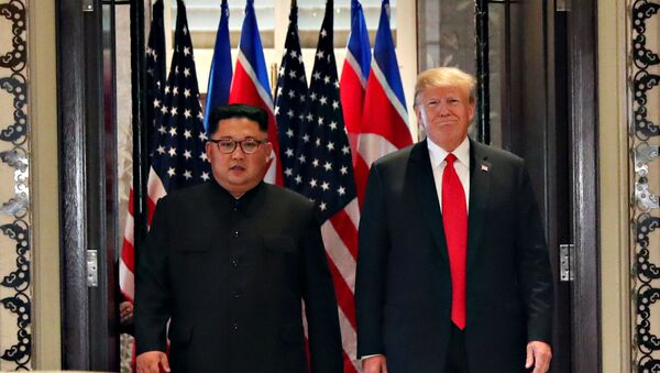 U.S. President Donald Trump and North Korea's leader Kim Jong Un arrive to sign documents that acknowledge the progress of the talks and pledge to keep momentum going, after their summit at the Capella Hotel on Sentosa island in Singapore June 12, 2018 - Sputnik International