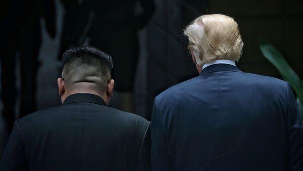U.S. President Donald Trump walks with North Korean leader Kim Jong Un at the Capella Hotel on Sentosa island in Singapore June 12, 2018 - Sputnik International