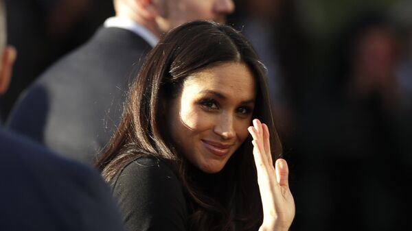 Meghan Markle waves as she leaves with Prince Harry after watching a hip hop opera performance by young people involved in the Full Effect programme at the Nottingham Academy school in Nottingham, England, Friday Dec. 1, 2017 - Sputnik International