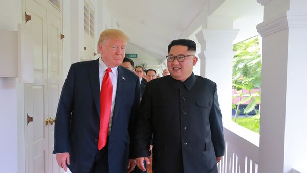 U.S. President Donald Trump walks with North Korean leader Kim Jong Un at the Capella Hotel on Sentosa island in Singapore in this picture released on June 12, 2018 by North Korea's Korean Central News Agency - Sputnik International