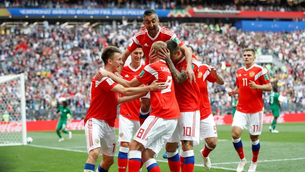 Soccer Football - World Cup - Group A - Russia vs Saudi Arabia - Luzhniki Stadium, Moscow, Russia - June 14, 2018 Russia's Yury Gazinsky celebrates scoring their first goal with team mates - Sputnik International