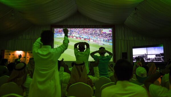 Saudi football fans cheer for their national team during their Russia 2018 World Cup Group A football match against Russia at a fan tent in the capital Riyadh on June 14, 2018 - Sputnik International